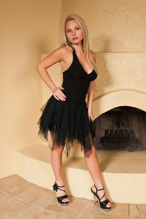 Pretty young blonde in a little black dress photo