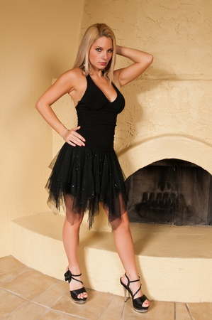 little black dress: Pretty young blonde in a little black dress
