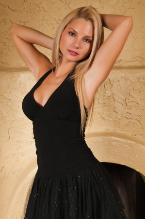 Pretty young blonde in a little black dress