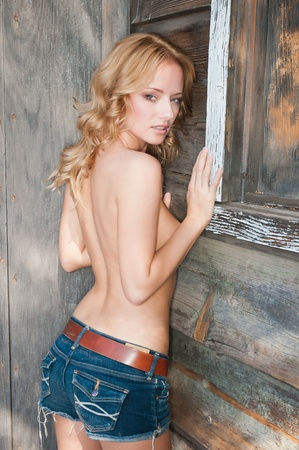 nude blond girl: Lovely young Hungarian blonde in an Old West setting