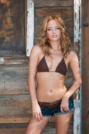 Lovely young Hungarian blonde in an Old West setting photo