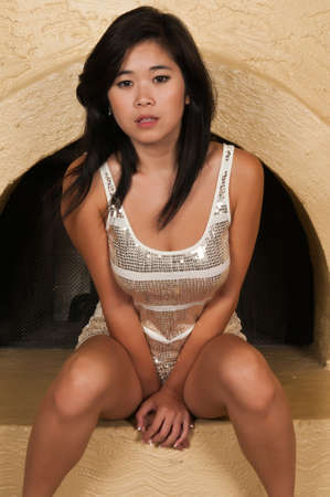 Pretty young Laotian woman in a sequined dress photo