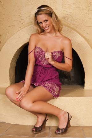 Pretty blonde woman in a purple dress Stock Photo - 11051323