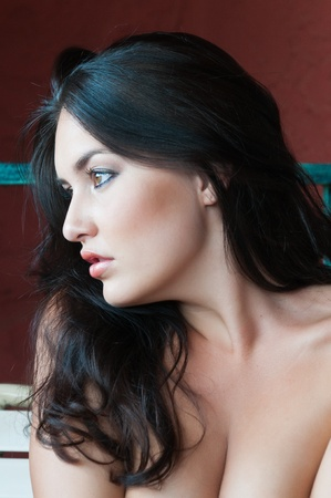 Pretty young brunette sitting topless on a hotel balcony Stock Photo - 11121447