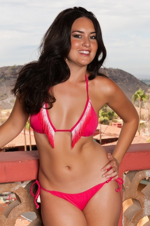 indian sexy: Pretty young brunette in a red bikini