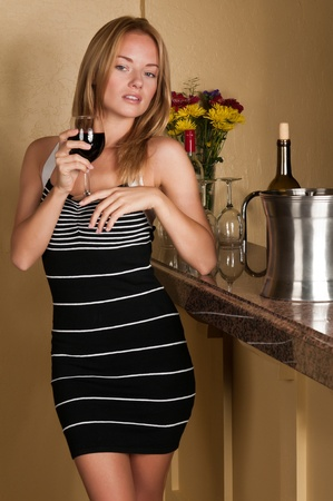 Lovely young blonde holding a wine glass photo