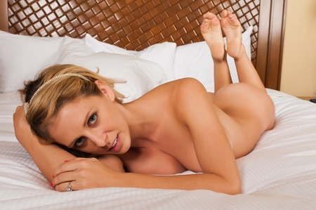 Sexy  woman naked: Pretty blonde woman lying in bed Stock Photo