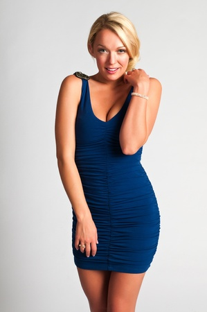 Pretty young blonde in a blue dress