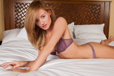Lovely young Hungarian blonde in purple lingerie photo