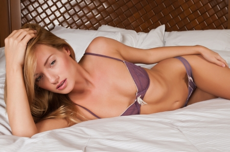 girls underwear: Lovely young Hungarian blonde in purple lingerie