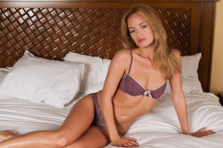undergarment: Lovely young Hungarian blonde in purple lingerie