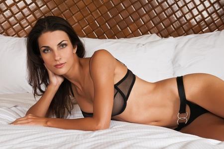 revealing: Beautiful slender brunette in sheer black lingerie