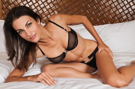 sheer lingerie: Beautiful slender brunette in sheer black lingerie