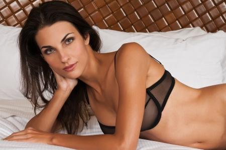 Beautiful slender brunette in sheer black lingerie Stock Photo - 11322018
