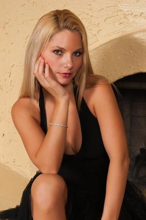 blonde little girl: Pretty blonde woman in a little black dress