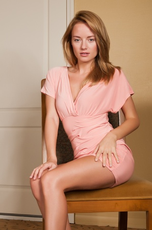 Lovely young Hungarian blonde in a pink dress photo