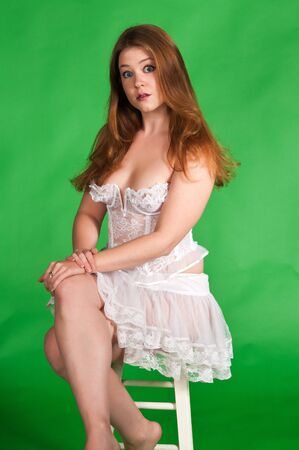 stool: Pretty young brunette in a white bustier