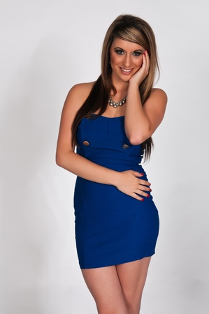 blue dress: Pretty young brunette in a short dress Stock Photo