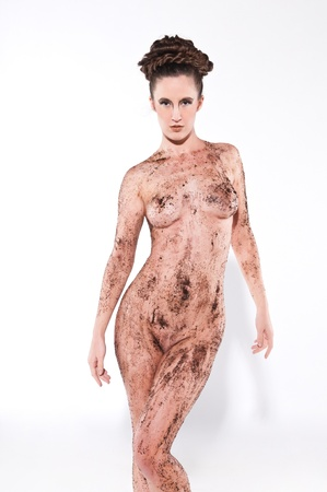 Tall nude brunette covered in coffee grounds