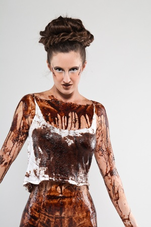 coffee grounds: Tall brunette covered in chocolate syrup and coffee grounds