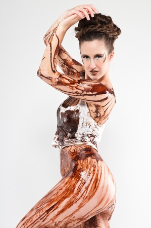 Tall brunette covered in chocolate syrup and coffee grounds