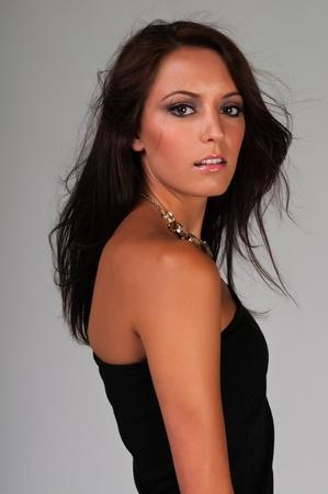 little black dress: Beautiful slender brunette in a little black dress Stock Photo