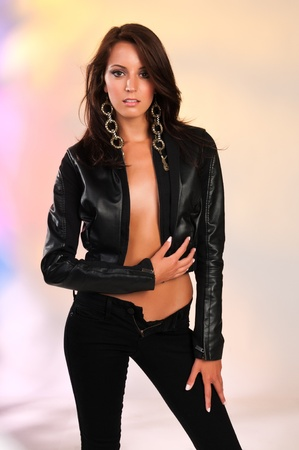Beautiful slender brunette in black leather Stock Photo - 11737048