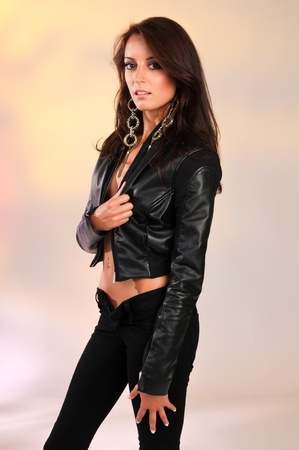 Beautiful slender brunette in black leather Stock Photo - 11737051