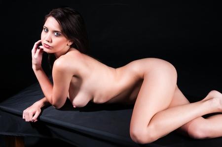 nude sexy girl: Pretty nude brunette in deep shadow