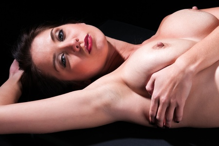 Pretty nude brunette in deep shadow Stock Photo - 11859207