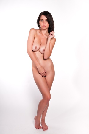 undressed young: Pretty young brunette nude against white Stock Photo