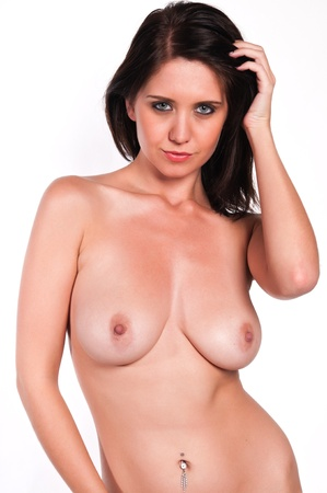 topless brunette: Pretty young brunette nude against white Stock Photo