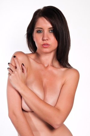 nude brunette: Pretty young brunette nude against white Stock Photo