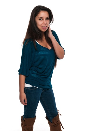Pretty young petite Latina in a teal blouse and jeans photo