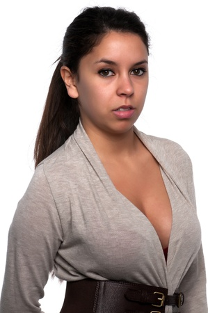 Pretty young petite Latina in a gray sweater Stock Photo