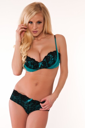 undergarment: Beautiful slender blonde in blue and black lingerie Stock Photo