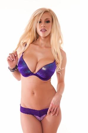 brassiere: Beautiful slender blonde dressed in purple lingerie