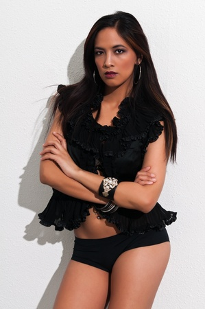 booty shorts: Pretty young Asian woman in a frilly black blouse and booty shorts