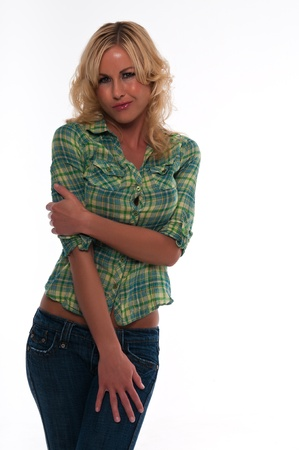 Pretty young blonde woman in a green plaid shirt and jeans Stock Photo - 12338199