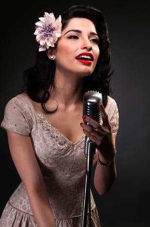 cream colored: Brunette chanteuse in a cream colored dress