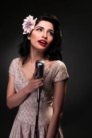 vocalist: Brunette chanteuse in a cream colored dress