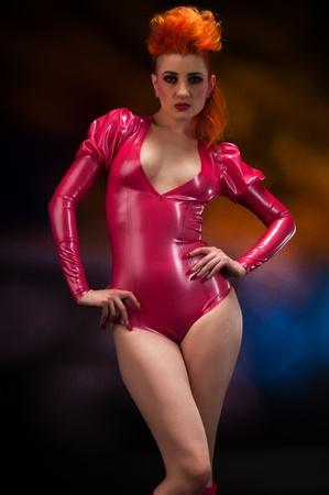 latex fetish: Pale slender redhead in latex fetish attire