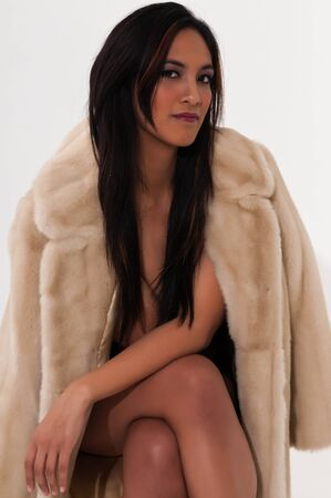 Pretty young Asian woman in a fake fur coat Stock Photo - 12439896