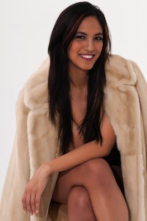 sexy asian woman: Pretty young Asian woman in a fake fur coat