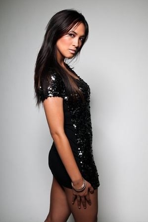 short dress: Pretty young Asian woman in a sequined black dress