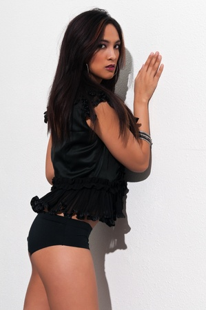 booty: Pretty young Asian woman in a frilly black blouse and booty shorts