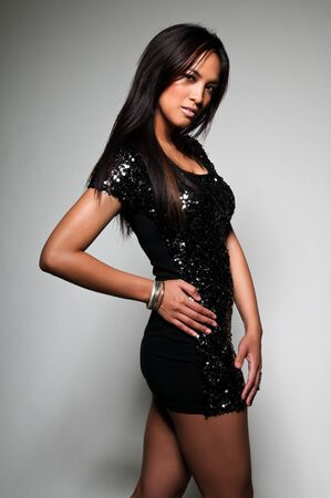 sequins: Pretty young Asian woman in a sequined black dress