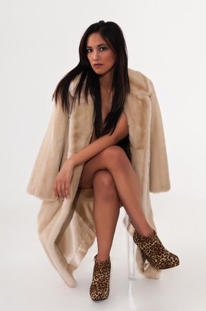 Pretty young Asian woman in a fake fur coat