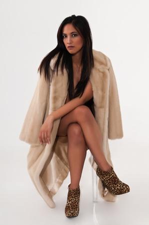 woman in fur coat: Pretty young Asian woman in a fake fur coat