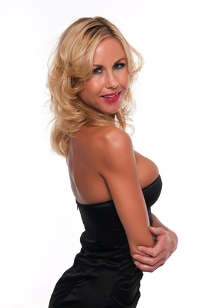 sheath: Pretty young blonde woman in a black sheath dress Stock Photo